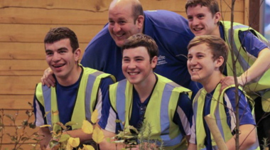 performance coach with young people smiling