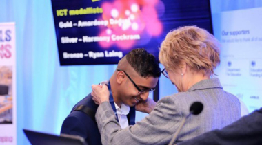 young person receiving medal