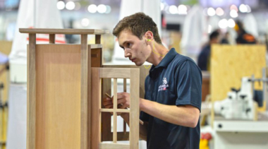 Young person building a cabinet