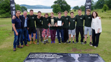 group shot of people holding a plaque