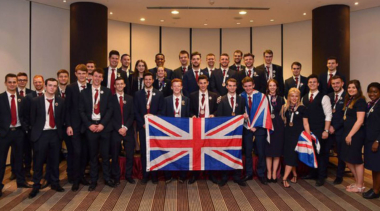 team uk formally dressed with medal and union jack