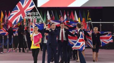 teamuk walking and holding union jack flag