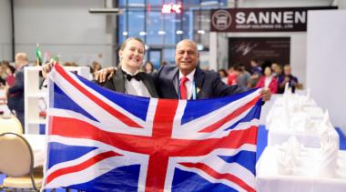 Collette at WorldSkills Kazan 2019 holding a union jack flag