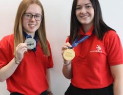 2 female students with medals