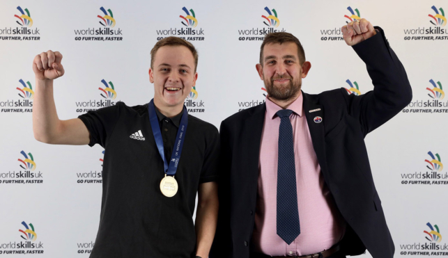 Photo of Dylan, Wall and Floor Tiling competitor celebrating his gold medal