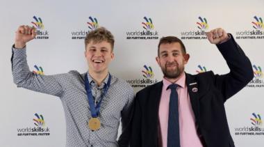 Photo of James, Squad UK Stonemasonry competitor celebrating his gold medal