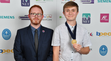 Photo of Web design competitor Lewis with his gold medal
