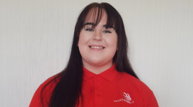 Photo of Molly, Health and Social Care competitor in her red Squad UK polo shirt