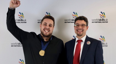 Photo of Lewis celebrating winning his gold medal as a chemical laboratory technician