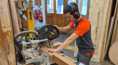 Photo of Ross sawing wood in joinery