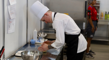 Photo of Sam competing in the cooking competition