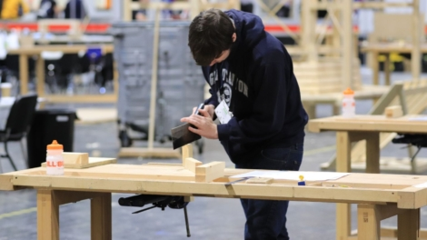 Photo of young person competing in Woodworking Foundation Skills competition
