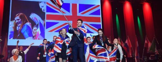 Photo of competitors carrying UK flags on stage at WorldSkills Gothenburg 2016