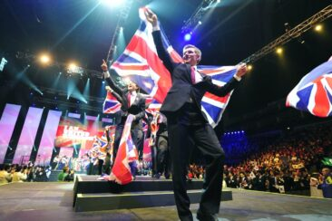 Photo of competitors carrying UK flags on stage at WorldSkills London 2011