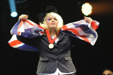 Photo of competitor with medal and flag at WorldSkills London 2011