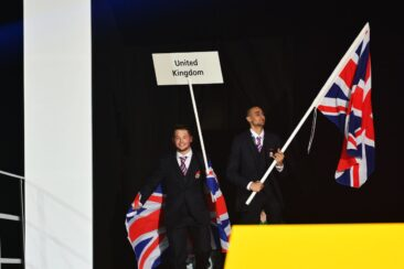 Photo of competitors carrying UK flags on stage at WorldSkills Leipzig 2013