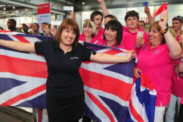 Photo of competitor with flag and supporters in WorldSkills Leipzig 2013