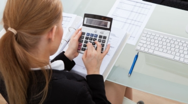 Photo of accountant typing into calculator
