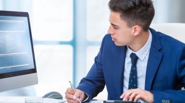 Photo of accountant looking at computer screen