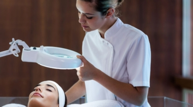 Photo of a beauty therapist giving a facial
