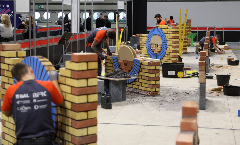 Young people competing in Bricklaying competition