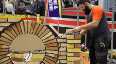 Young person competing in Bricklaying competition