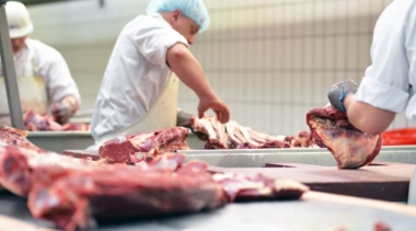 Photo of butchers preparing meat