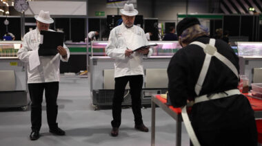 Young person competing in Butchery competition