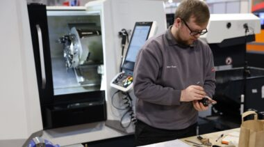 Young person competing in CNC Turning competition