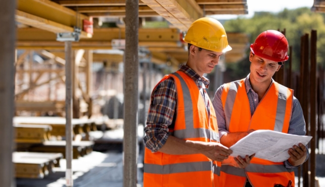 Photo of two construction project managers reviewing plans