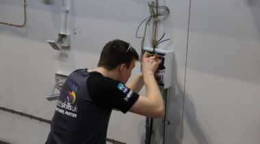 Young person competing in Electrical Installation competition