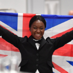 Photo of Restaurant Service competitor Elizabeth celebrating with the Union Jack