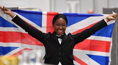 Photo of Restaurant Service competitor Elizabeth celebrating with the Union Jack