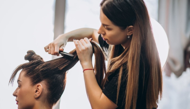 Photo of hairdresser cutting customer's hair