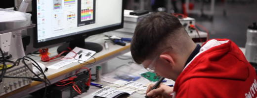 Young person competing in Industrial Electronics competition