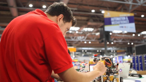 Young person competing in Industrial Robotics competition