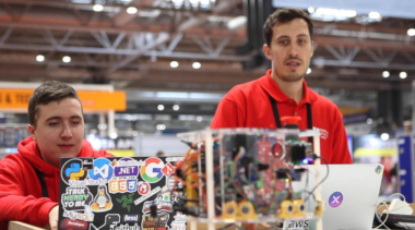 Young people competing in Industrial Robotics competition