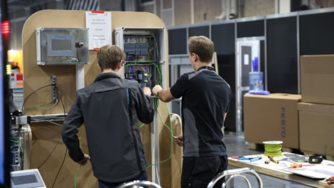 Young people competing in Industrial Control competition