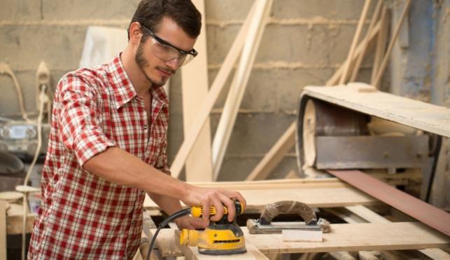 Photo of joiner sanding piece of wood