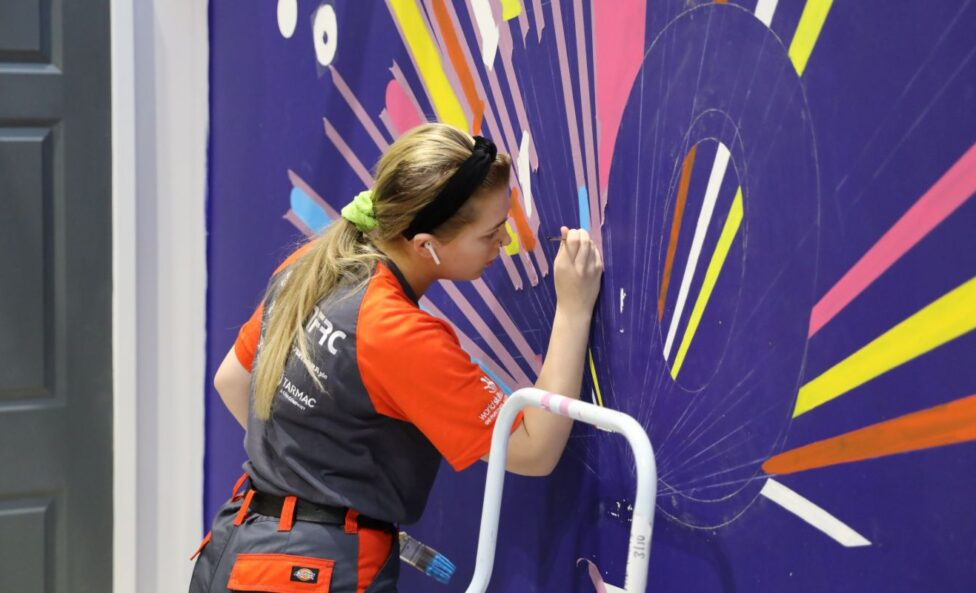 Young person competing in Painting and Decorating competition
