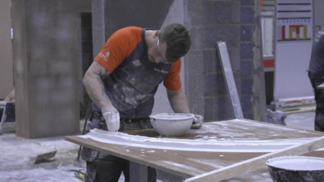 Young person competing in Plastering competition