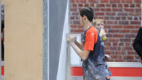 Young person competing in Plastering and Drywall Systems competition