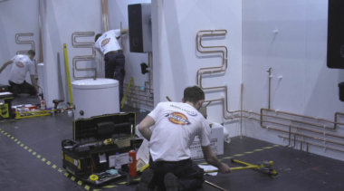 Young people competing in Plumbing competition