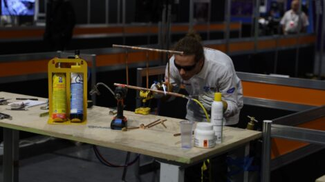 Young person competing in Refrigeration competition