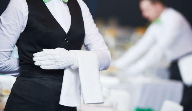 Photo of young waitress in a smart restaurant