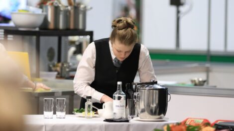 Young person competing in Restaurant Service competition