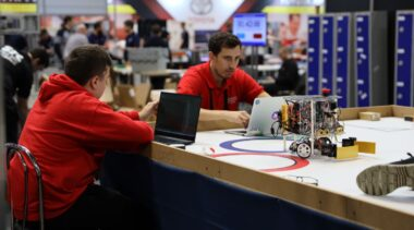 Young people competing in Robotics competition