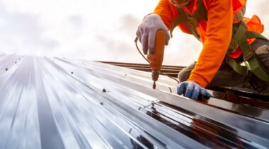 Photo of roofer installing a metal roof