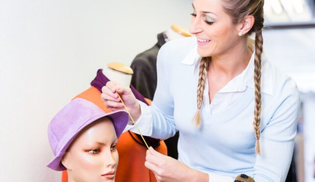 Photo of Visual Merchandiser dressing mannequin