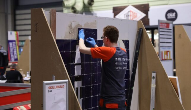 Young person competing in Wall and Floor Tiling competition